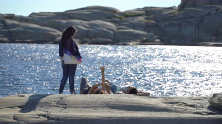 granit : TJOME, NORWAY - JULY 01, 2018: People resting on the coastal stones in Tjome nature Park on the South coast of Norway is a favorite place for tourists and local Wideo