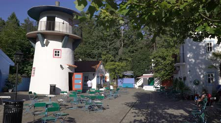 посетитель : KRISTIANSAND, NORWAY - JULY 07, 2018: The amazing Cardamom Town is based on the book of childrens writer Egner Thorbjorn. Childrens amusement Park Dyreparken in southern Norway