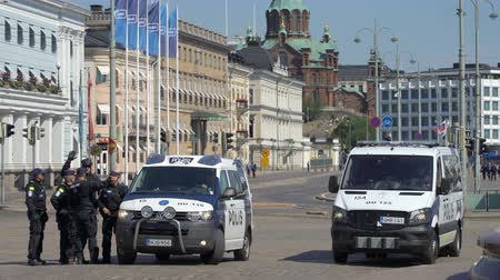 donald trump : HELSINKI, FINLAND - JULY 16, 2018: Meeting trump and Putin in Helsinki. Security measures. Riot police monitoring protests against the meeting between Trump and Putin