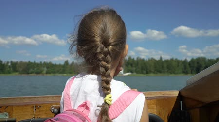 sail rock : Little girl admiring the coastline of aboard a boat. Boating among the Islands of southern Finland in the Baltic sea.