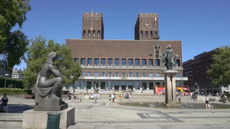 nobel : OSLO, NORWAY - JUNE 30, 2018: The famous city hall on the waterfront of Aker Brugge in the center of Oslo. Annually the Nobel Peace Prize ceremony takes place in this building. Stock Footage