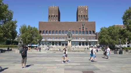 nobel : OSLO, NORWAY - JUNE 30, 2018: The famous city hall on the waterfront of Aker Brugge in the center of Oslo. Annually the Nobel Peace Prize ceremony takes place in this building. dolly shot