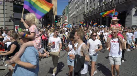 af : OSLO, NORWAY - JUNE 30, 2018: Huge costume crowd sings and dances. The Pride Parade, the highlight of Oslo Pride Week, is a huge, vibrant parade filling the city streets.