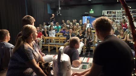 staging : JYVASKYLA, FINLAND - AUGUST 17, 2018: Actors of the theater Art master and the audience discuss the performance after the show during the international theatre festival Art-Workshop