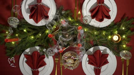 Festive christmas red table setting with candles and garland. Top view Vídeos