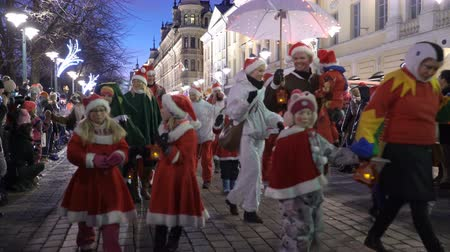 HELSINKI, FINLAND - NOVEMBER 26, 2017: The traditional parade of Santa Claus during the opening of the Christmas holidays. Stock mozgókép