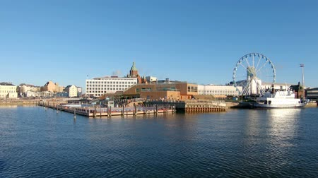 View of the Allas sea basin and the Ferris wheel from the Helsinki-Suomenlinna sea ferry