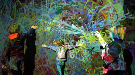 HELSINKI, FINLAND - JAN 06, 2019: Massless Exhibition - immersive interactive graphic digital installations by a group of Japanese artists TeamLab at the Amos Rex Museum. Children and adults enjoy the new modern digital art