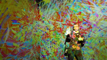 HELSINKI, FINLAND - JAN 06, 2019: Massless Exhibition - immersive interactive graphic digital installations by a group of Japanese artists TeamLab at the Amos Rex Museum. Visitors enjoy the new modern digital art. Woman taking selfies