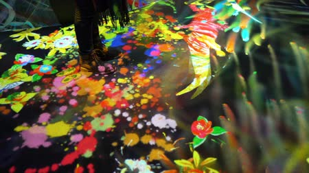 HELSINKI, FINLAND - JAN 06, 2019: Massless Exhibition - immersive interactive graphic digital installations by a group of Japanese artists TeamLab at the Amos Rex Museum. Visitors enjoy the new modern digital art