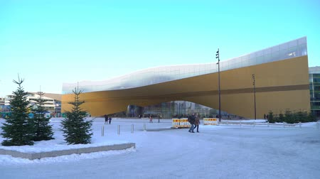 HELSINKI, FINLAND - JAN 12, 2019: Helsinki City Central Library Oodi is a new cultural and media hub and a non-commercial, urban public meeting space opening to all. Its modern building with its glass and steel structures and wooden facade