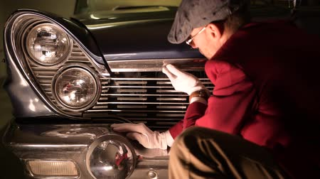collectible : Caucasian Classic Car Specialist in Process Of Vehicle Appraisal