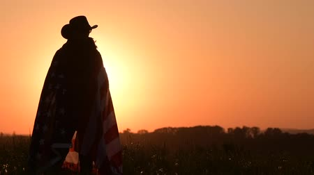 western wear : Western Wear Caucasian Men with United States Flag in Hands. Scenic Sunset. Slow Motion Footage