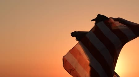 western wear : Cowboy Playing with American Flag During Scenic Sunset. Independence Day Celebration