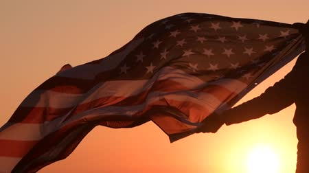 western wear : American Patriot with USA Flag During Scenic Sunset Stock Footage