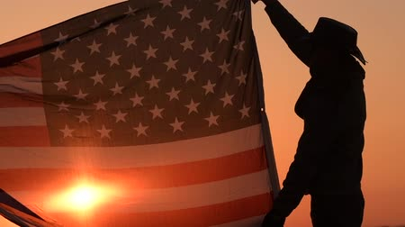 western wear : Slow Motion Footage of Cowboy with United States of America Flag in Slow Motion