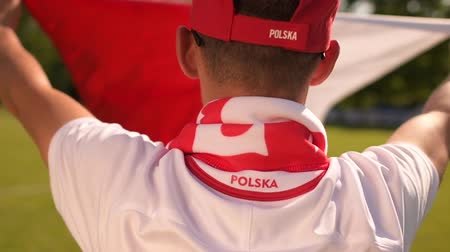 вратарь : Polish Football Fan with National Flag in Slow Motion Стоковые видеозаписи