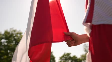 štěrbina : Polish Soccer Fan with Red and White National Flag of Poland. Slow Motion Footage