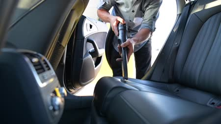 labour : Car Vacuum. Caucasian Men Cleaning His Car Inside by Vacuuming
