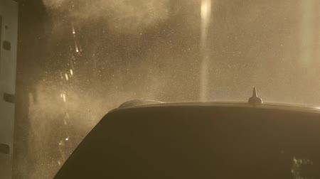 lavagem : Slow Motion Footage of Water Spraying Automatic Car Wash Vídeos
