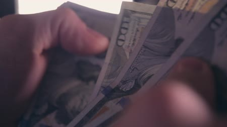 bens : Closeup Video of Caucasian Hands and Money Counting. American Dollars Cash Count.