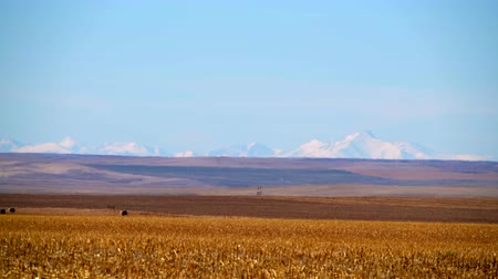 denver : State of Colorado Plains. Raw Colorado Landscape in November. Rocky Mountains Covered By Snow on the Horizon