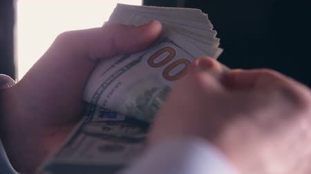us banknotes : Caucasian Business Owner Counting One Hundred Dollars Bills in His Hands Stock Footage