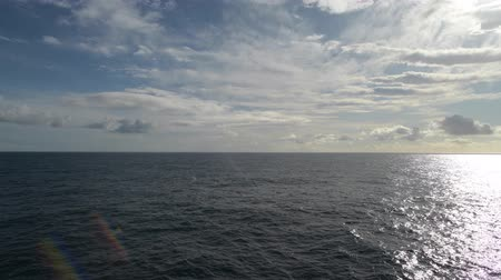 águas : Summer on the Atlantic Ocean. Sea Travel. Footage Taken From Cruise Ship. Calm Sea Waters and Partly Cloudy Sunny Weather.
