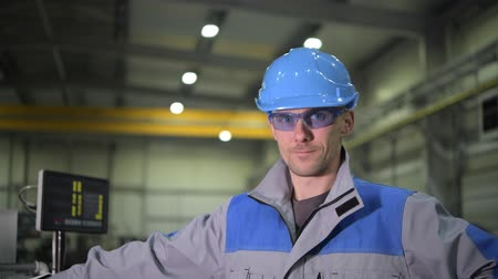 fixní : Caucasian Worker Wearing Safety Glasses and Blue Hard Hat. Caucasian Engineer Portrait.