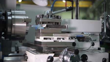 tokarka : Engineer Working on Metal Lathe. Closeup 4K Video with Slight Motion