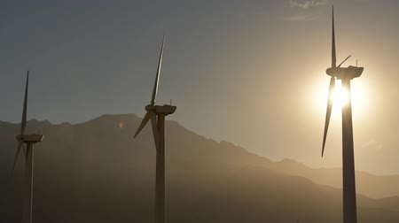 obnovitelný : Wind Turbines During Scenic Sunset in California Coachella Valley Sunset. Renewable Wind Energy