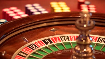 ruletka : Spinning Roulette Wheel. Las Vegas Roulette Game. Wheel and Gambling Chips. Closeup Video Slow Motion Footage