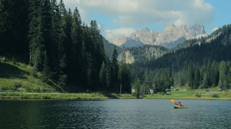 kano : Kayaking on Lake Misurina in Italian Dolomites. Kayaker on the Lake.