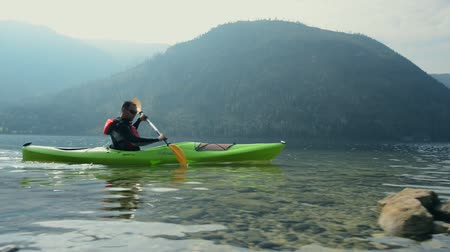 kano : Kayak Tour on the Scenic Lake. Caucasian Kayaker Paddling in His Kayak.