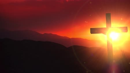 vöröses : The Light of Christ Old Wooden Crucifix on the Desert During Scenic Sunset. Christian Cross Sunset Background Animation