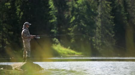 truta : Fly Fishing Theme with Caucasian Fisherman in His 30s on the Edge of Scenic River.