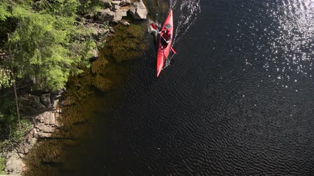 caiaque : Scenic River Kayaking Aerial View. Caucasian Men Paddling in a Kayak.