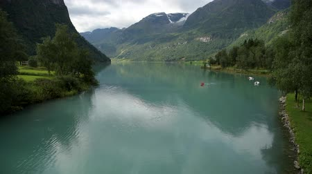 canoa : Caucasian Men Kayaking on the Scenic Glacial Lake in Norway