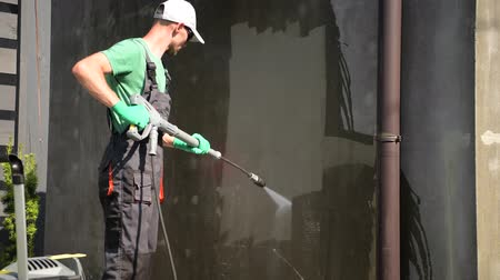 deterjan : Cleaning Dirty House Walls by Pressure Washer. Caucasian Cleaning Specialist