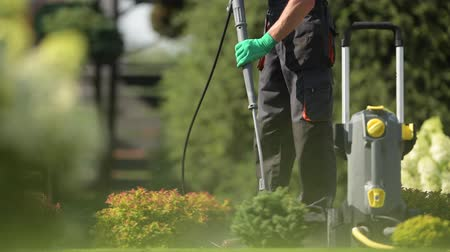 deterjan : Summer Cleaning Time in the Garden. Washing Paths Using Pressure Washer