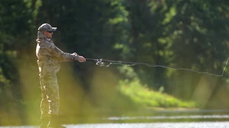 truta : Fly Fishing on the Scenic River. Slow Motion Footage Stock Footage