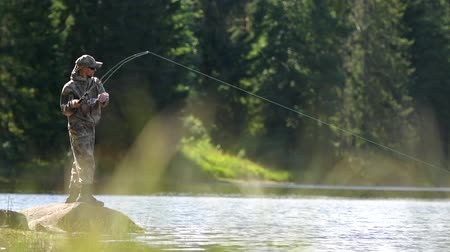 truta : Caucasian Men Fly Fishing in Slow Motion Stock Footage