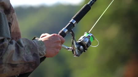outdoor hobby : Fishing Rod in Action. Slow Motion Footage. Fly Fishing. Stock Footage