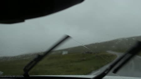 İskandinav : Car Windshield Wipers Slow Motion Footage. Wilderness Scandinavian Road and the Rainy Weather.