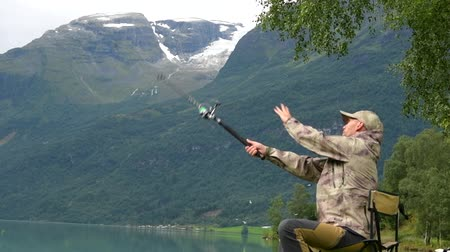 truta : Slow Motion Footage of Fisherman Fly Fishing on the Glacial Lake Stock Footage