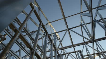madeira compensada : Skeleton Steel Frame. Modern House Construction. Camera Movement. Stock Footage