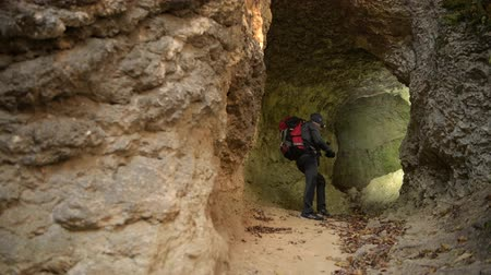 gruta : Small Cave Exploring by Caucasian Hiker in His 30s. Stock Footage