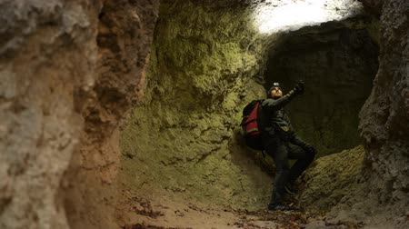 gruta : Caucasian Men in His 30s with Flashlight Exploring Grotto. Geological Researcher.