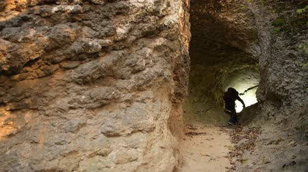 gruta : Geological Researcher. Caucasian Men in His 30s with Flashlight During Cave Exploring. Vídeos