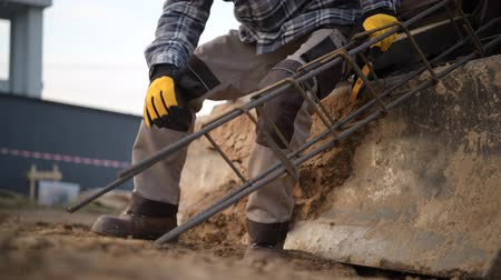 brake : Construction Worker with Metal Building Enforcement Element Taking Short Brake. Stock Footage